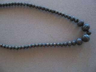 An old out of pawn Navajo silver bead necklace. It measures 23 inches