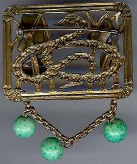 ART DECO EGYPTIAN LADY & SNAKE BRASS GREEN GLASS DANGLE PIN